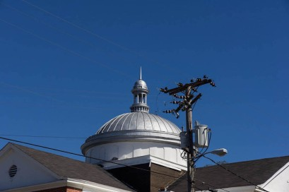 Wooden dome with metal cap and belltower
