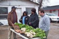 Buying greens from the community vendor